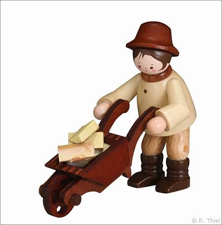 Forest worker with wheelbarrow
