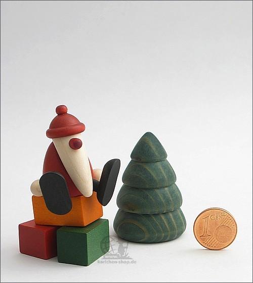 Weihnachtsmann auf Kante, Baum und Geschenke - Miniaturset 1