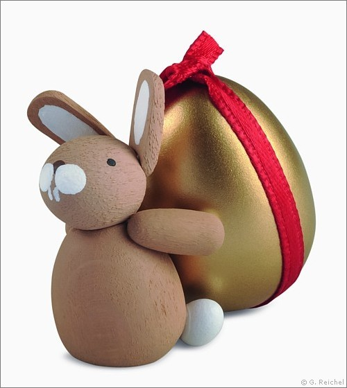 Bunny with gold colored egg