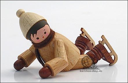 Winterkind mit Schlittschuh, gestürzt