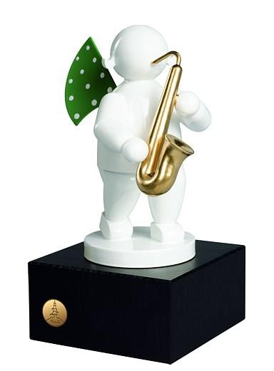 Engel mit Saxophon auf kleinem Sockel