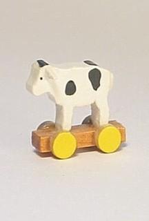 little calf on a wheel board
