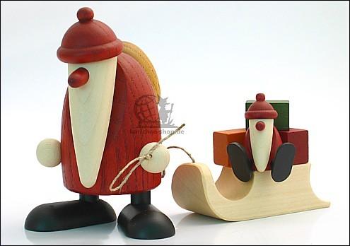 Weihnachtsmann mit Schlitten und Kind